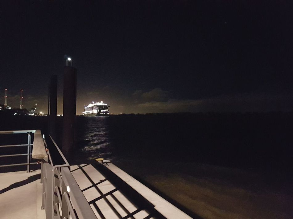 with a cruis ship go on a big journey Dark Sky Water Hamburg Elbe Willkomm-Höft Wedel Evening Atmosphere Fantastic Atmosphere Railing Shining Ship Cruise Ship Outdoor Photography No People