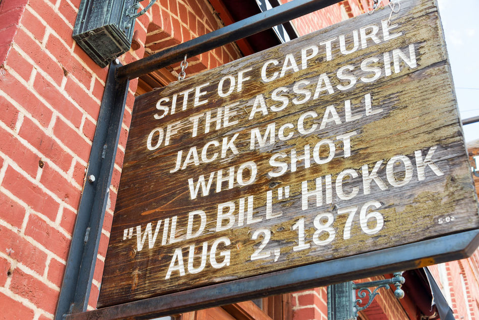 Sign marking the site where Jack McCall was captured after murdering Wild Bill Hickok Architecture Bar Bill Hickok Black Hills Brick Casino Deadwood  Downtown Historic Hotel Jack Mccall Old West  Restaurant Sign South Dakota Tavern  Tourism Tourists Town Travel Travel Destinations USA Western Wild Bill Hickok Wild West