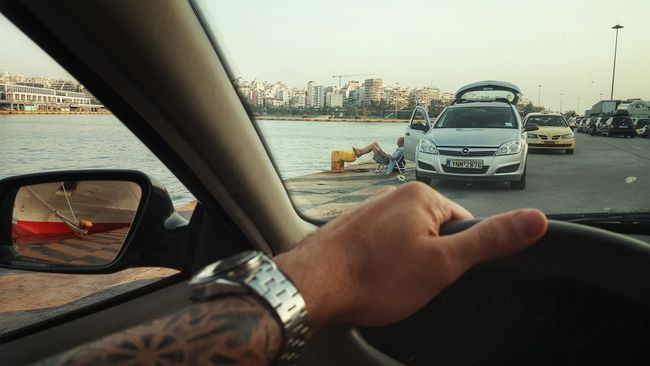 Meinautomoment From My Point Of View The Human Condition Old Man Relaxing Reading A Book By The Sea Port Life Extraordinary  Summer Hot Day Human Representation Human Settlement Human Body Part Tattooed Human Hand In The Car Tattoo Cape Point Port Sea Car Cityscape City View  Selective Focus