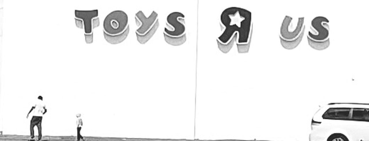 Dad and his son Day Outdoors Fun With Dad Toys R Us Black & White