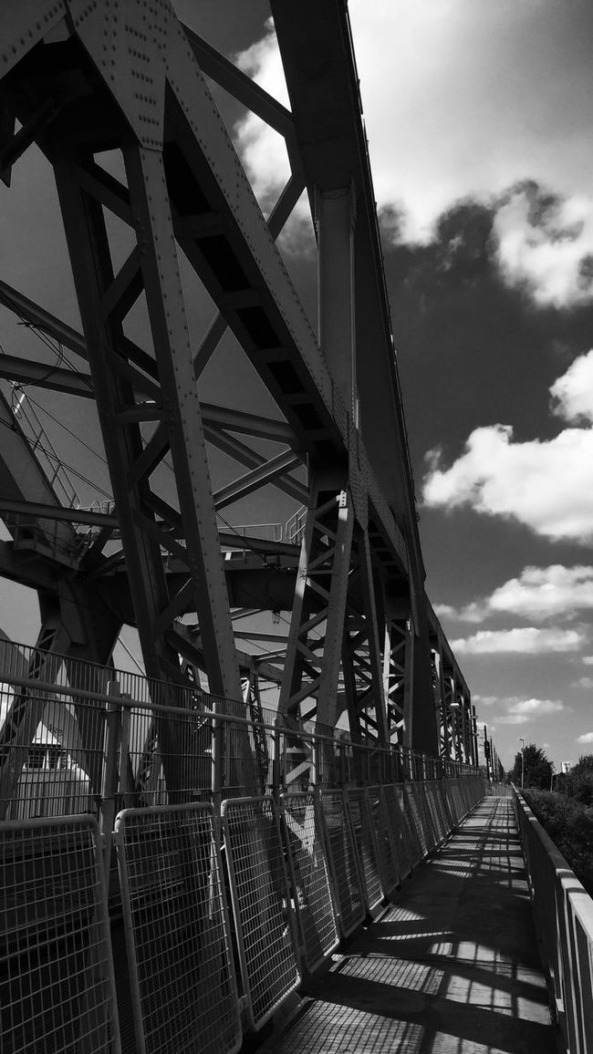 Industrial Metal Bridge Construction Blackandwhite Monochrome Black And White Street Photography Outdoors Sky Clouds Black & White EE Love Connection! Taking Photos Eeyem Photography Eye4photography  EyeEmBestPics Silhouette Light And Shadow Streetphotography Eyem Best Shots Sun Shadow Shades Of Grey