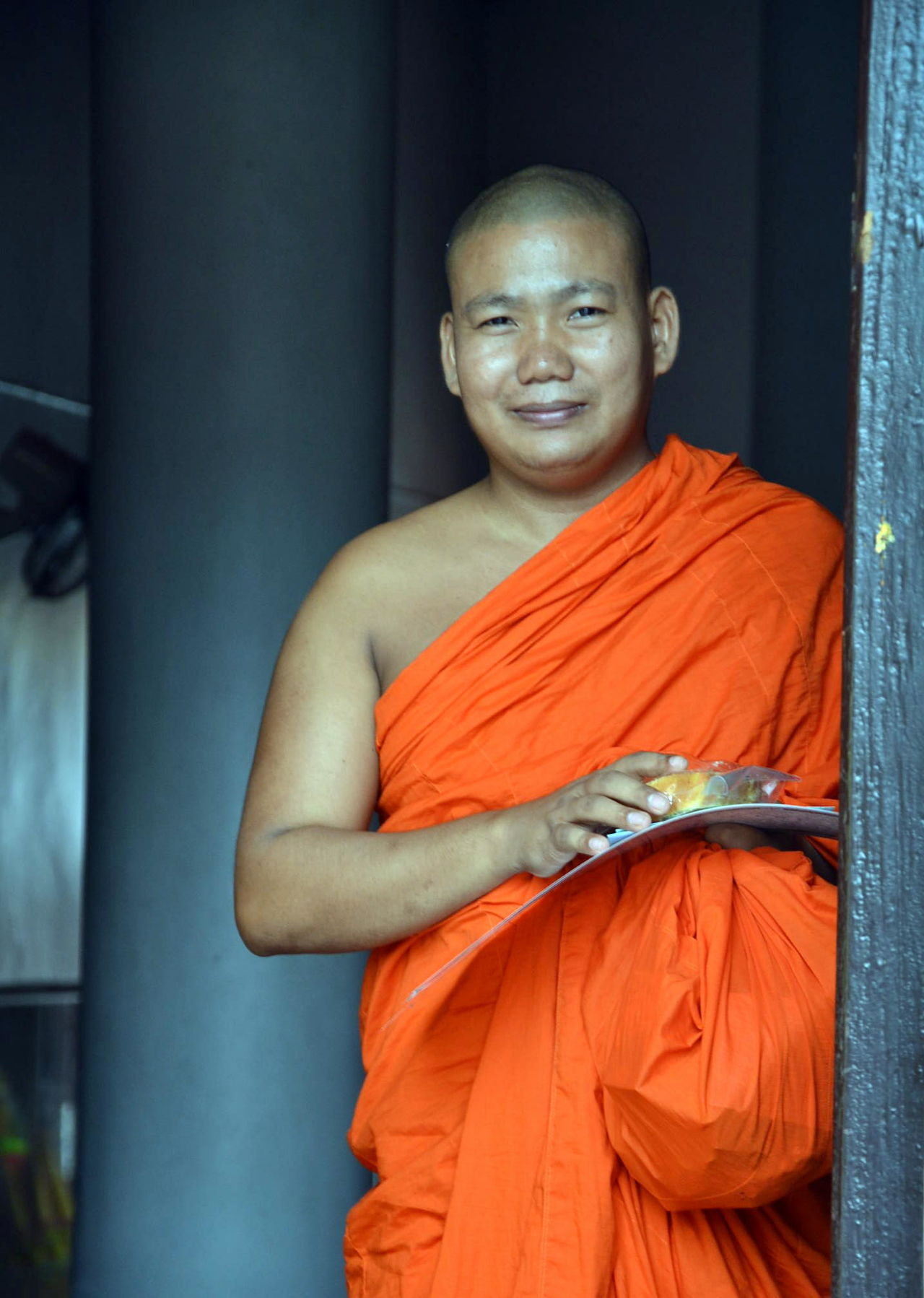 Buddhism Buddhist Monks Day Looking At Camera Looking At Camera One Man Only One Person Orange Color Orange Colour Portrait Religion Religion And Beliefs Smiling Standing Thailand Traditional Thailand Travel Thailand Trip Three Quarter Length Young Adult