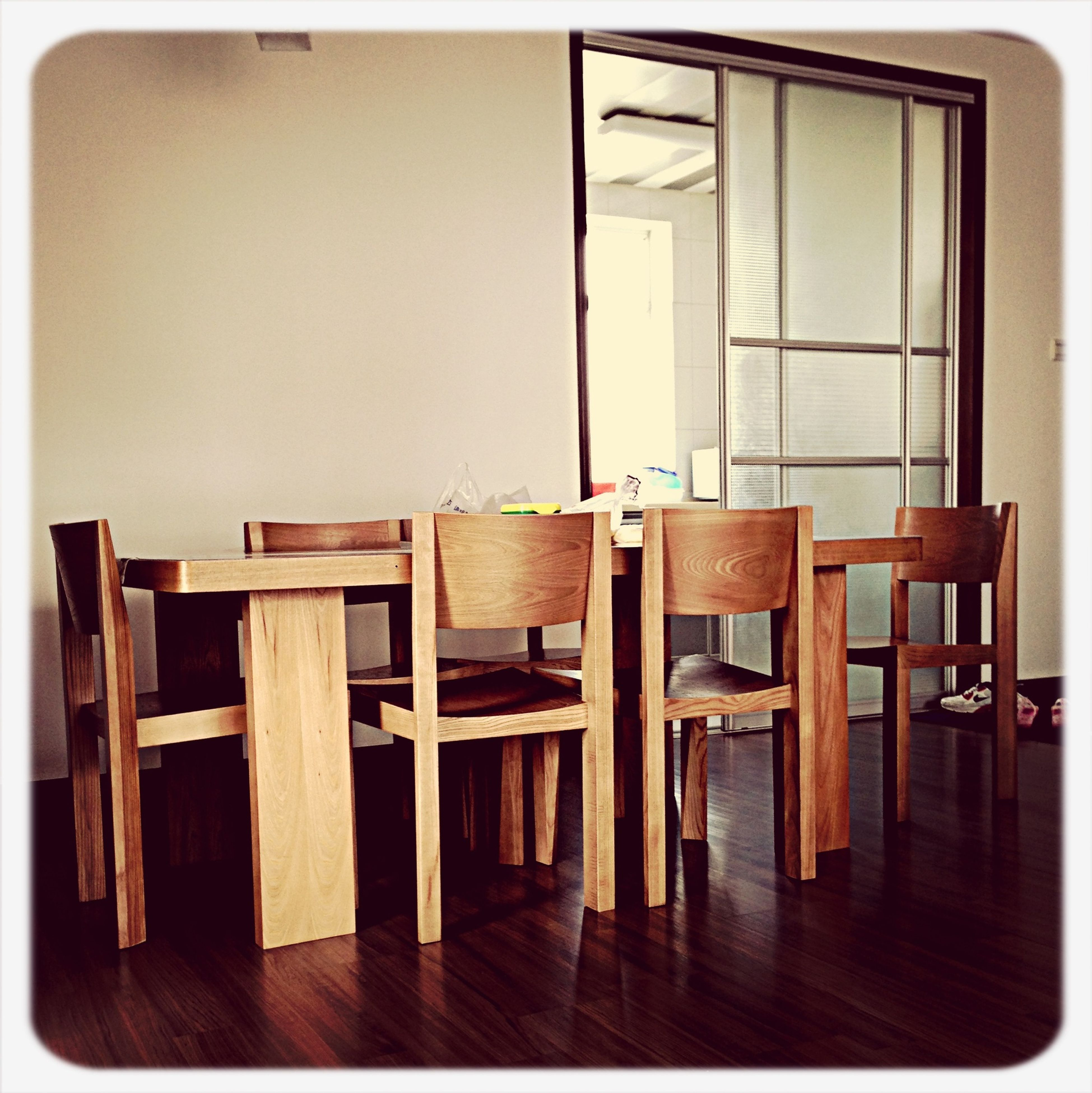 indoors, wood - material, transfer print, table, chair, absence, empty, auto post production filter, wood, furniture, wooden, home interior, built structure, no people, house, architecture, book, hardwood floor, window, day