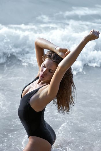 Young Adult Young Women Water One Person Leisure Activity Three Quarter Length Lifestyles Real People Sea Day Beautiful Woman Outdoors Beach Nature Motion Portrait Standing Beauty Beauty In Nature Sky