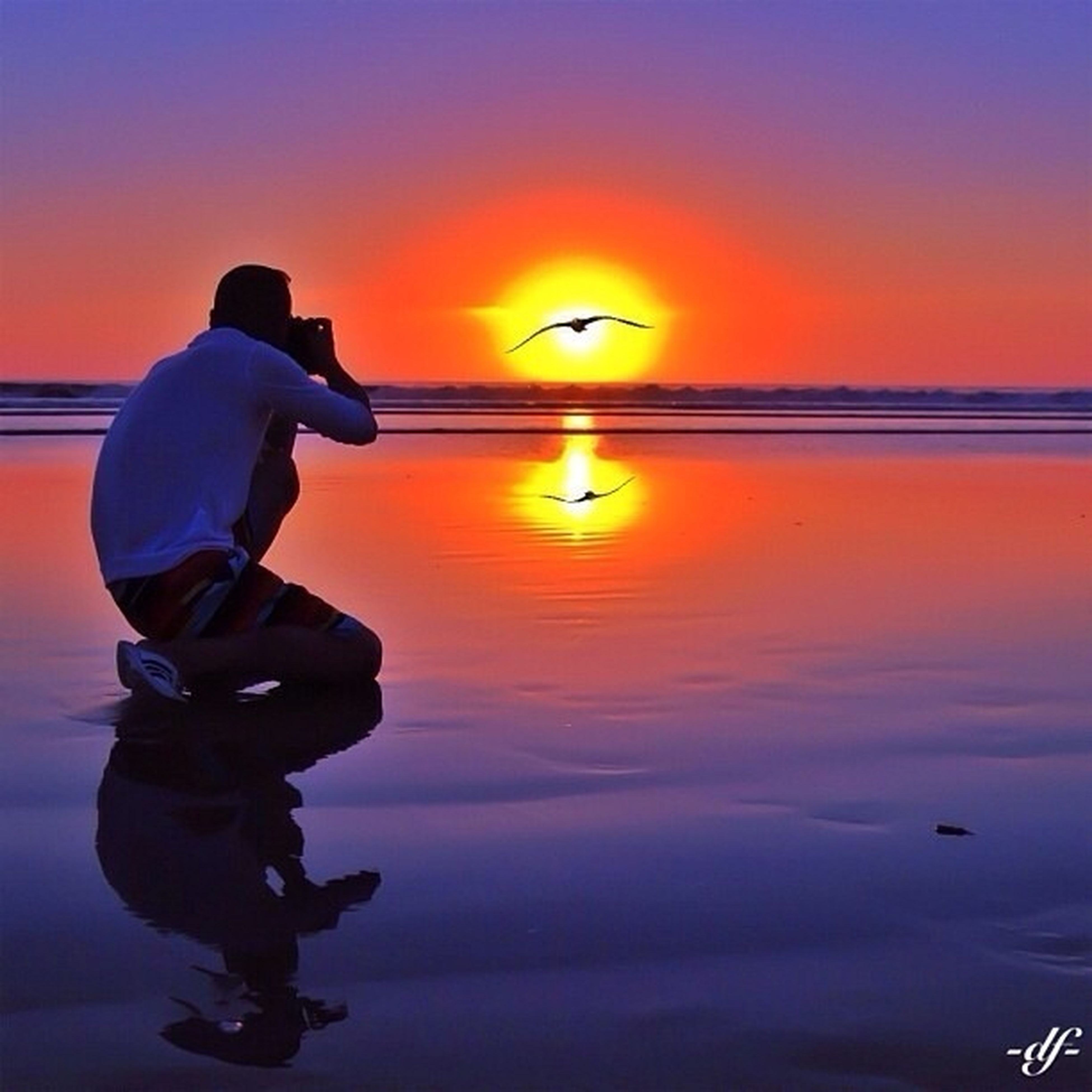 sunset, orange color, water, silhouette, sea, lifestyles, men, horizon over water, scenics, leisure activity, sun, beauty in nature, sky, standing, reflection, tranquility, tranquil scene, idyllic