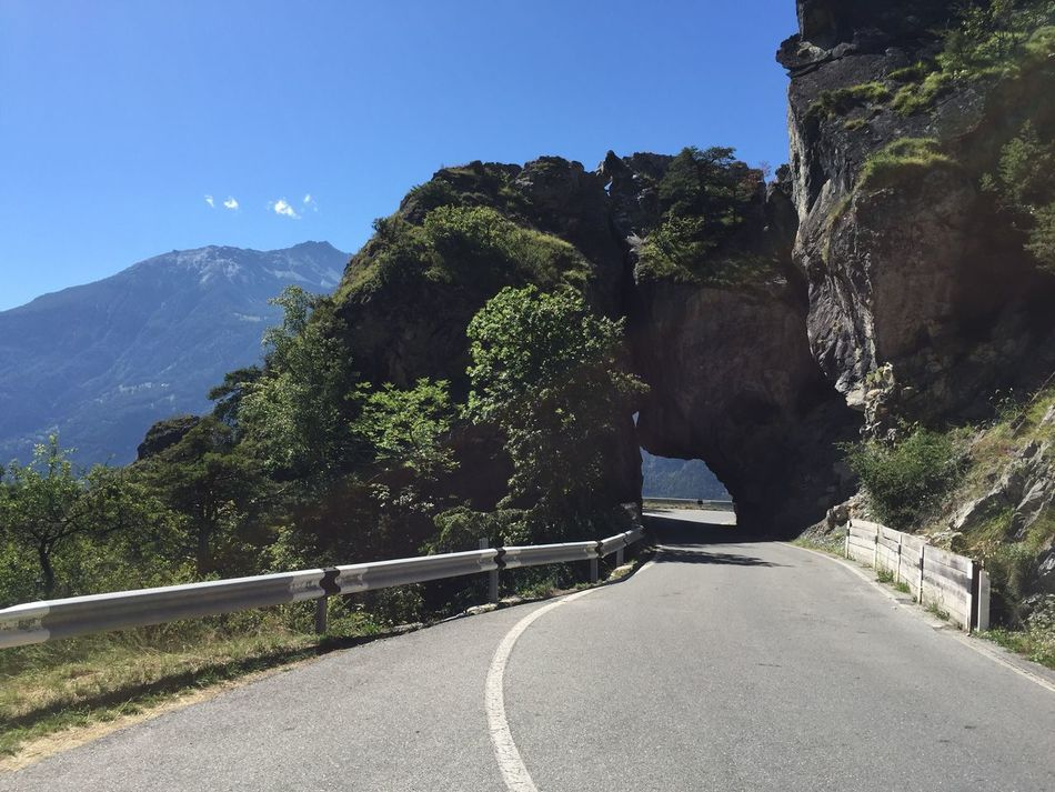 Road Country Road Curve Natural Tunnel Swiss Alps Mountain Scenics Tranquility Tranquil Scene Solitude Nature Sunny Day Clear Sky The Way Forward Beauty In Nature Vacation Leuk Switzerland