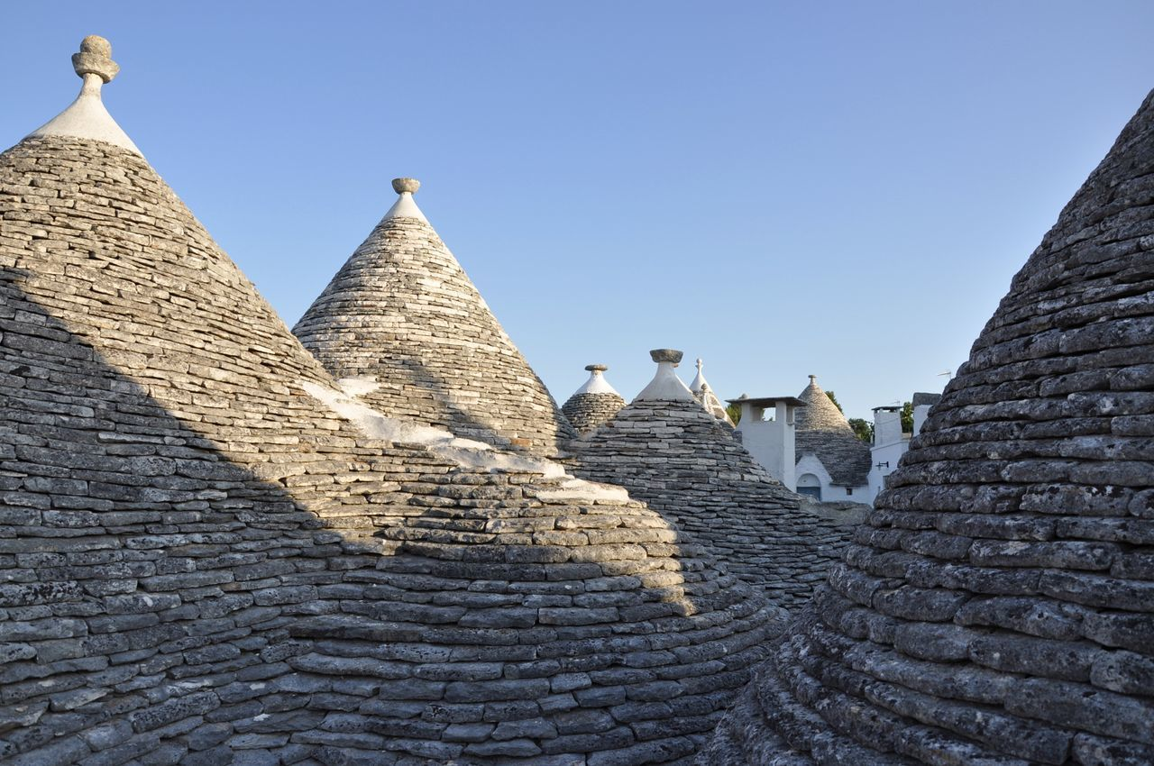Alberobello Ancient Ancient History Architecture Architecture Blue Brick Building Building Exterior Built Structure City History Italy Low Angle View No People Outdoors Puglia Roof Rooftop Sky The City Light Travel Travel Destinations Trulli Minimalism