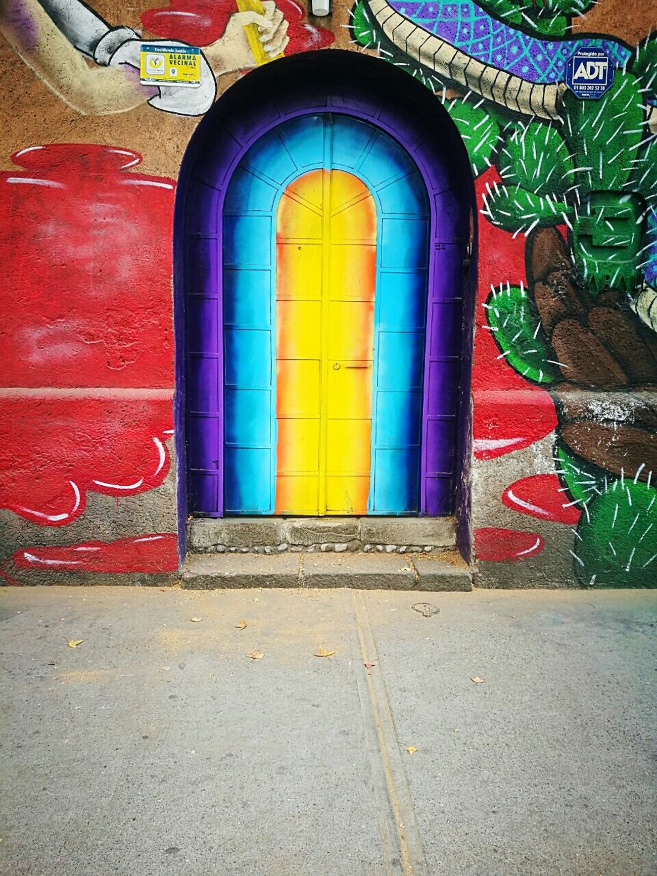 Multi Colored Built Structure No People Architecture Arch Day Outdoors Door Yellow Blue Purple Street Acera Road Mural Mural Art Pintura Paint Color Colors Colorful Leicacamera Red