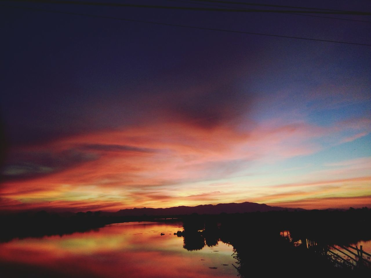 sunset, scenics, silhouette, tranquil scene, tranquility, nature, sky, beauty in nature, no people, cloud - sky, water, outdoors, landscape, day