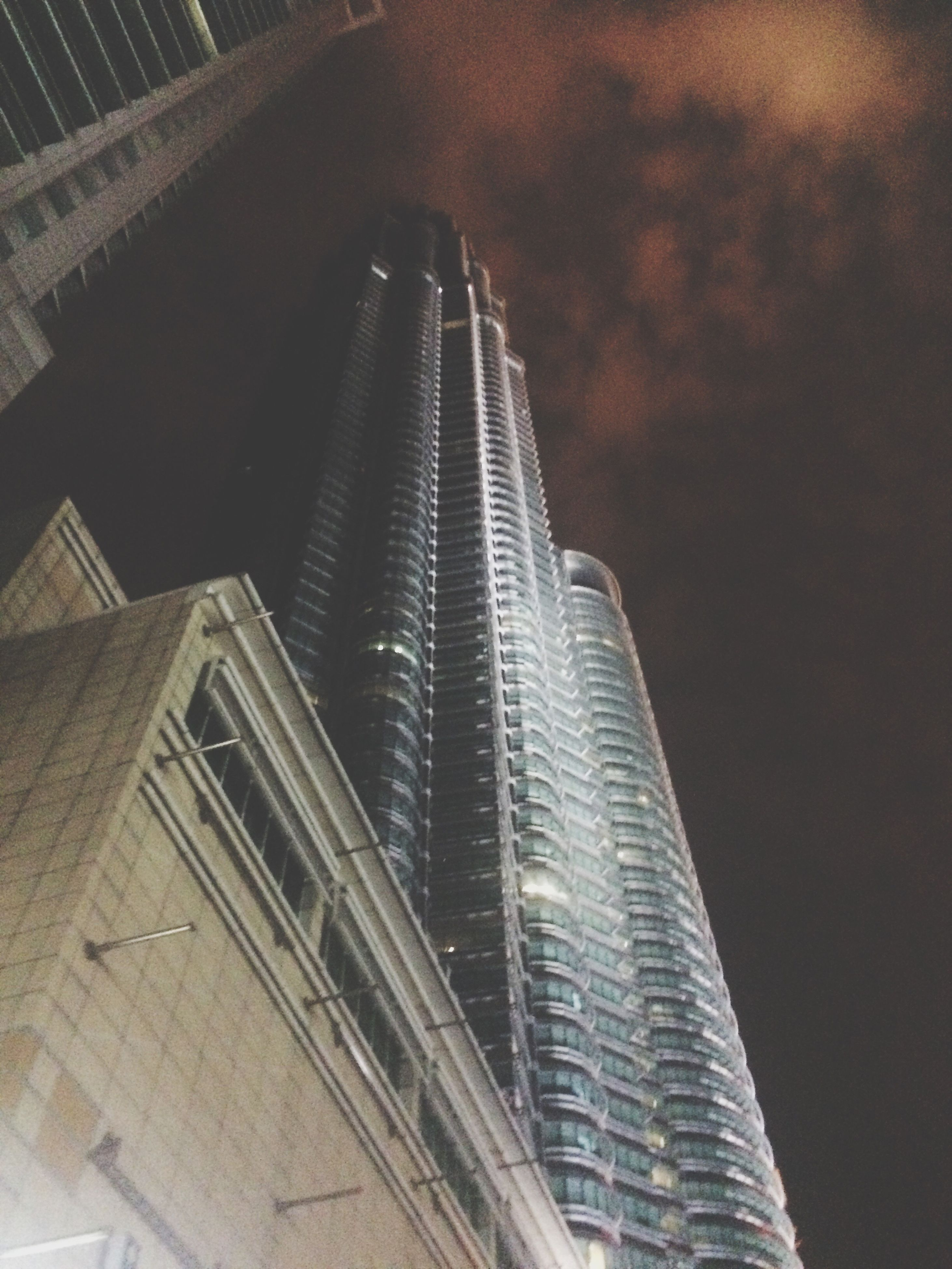 low angle view, architecture, building exterior, skyscraper, built structure, tall - high, tower, city, sky, office building, modern, travel destinations, city life, building story, architectural feature, capital cities, tall, outdoors, growth, spire, development, urban skyline, no people