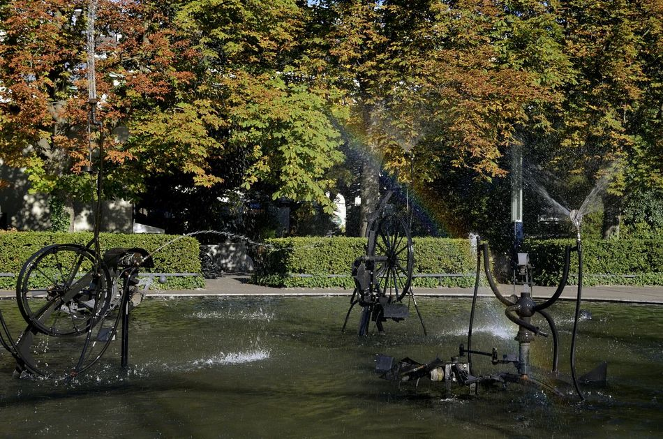 One of the most interesting fountains I've seen so far Fountain Tree Water No People Wet Outdoors Day Wheel Rainbow Rainbow Colors Basel Basel, Switzerland Fountain Fun