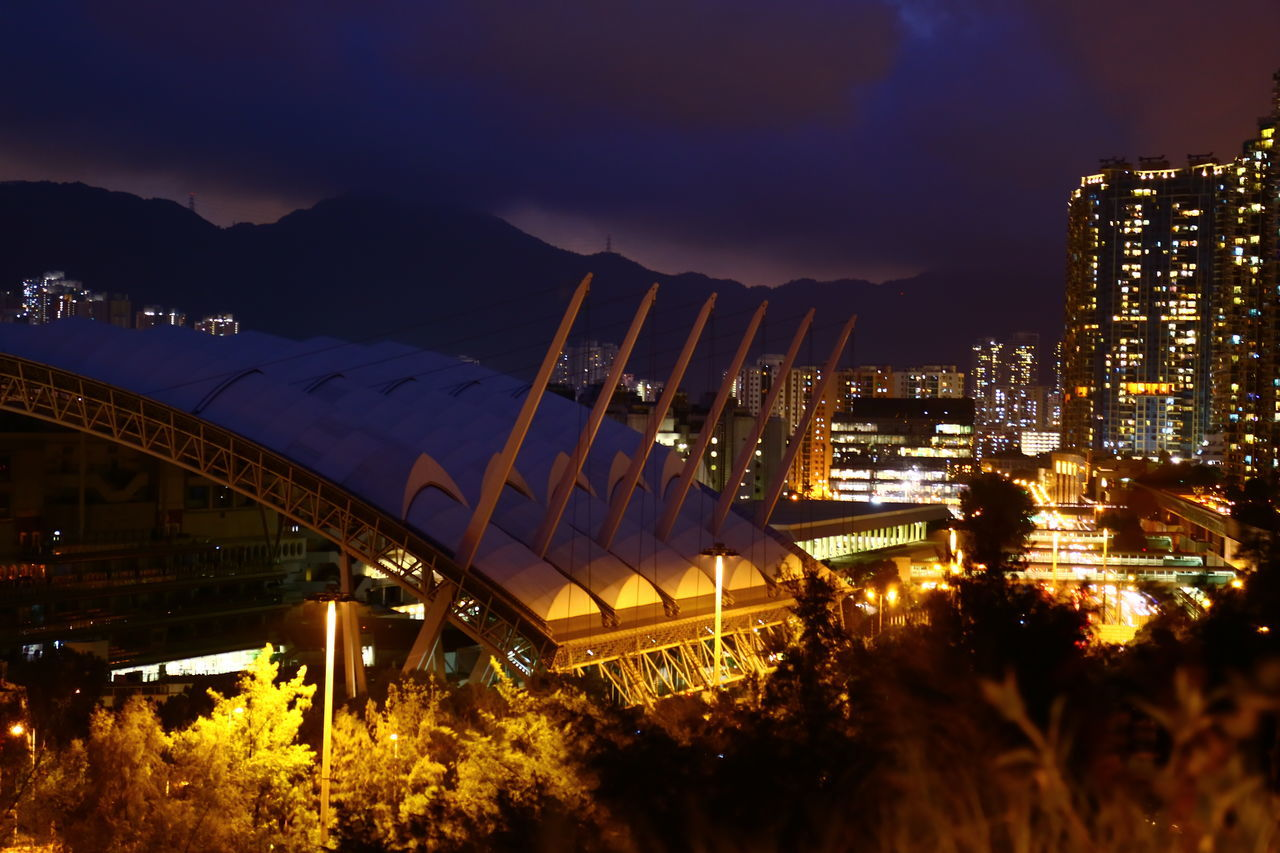 architecture, illuminated, built structure, outdoors, mountain, no people, sky, building exterior, night, city, nature