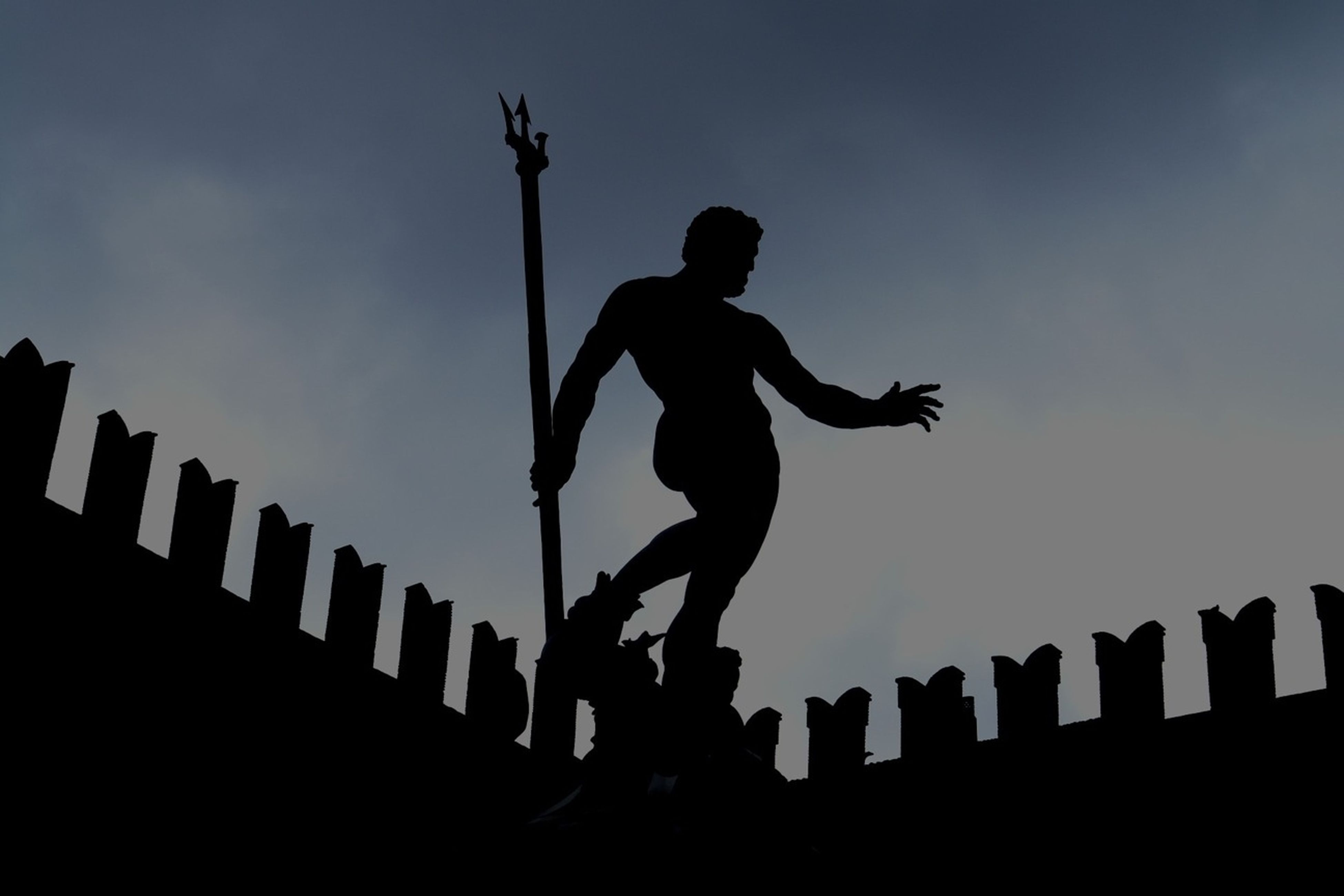 low angle view, silhouette, sky, lifestyles, leisure activity, men, full length, skill, arts culture and entertainment, performance, playing, outdoors, arms raised, musical instrument, enjoyment, standing, side view, motion