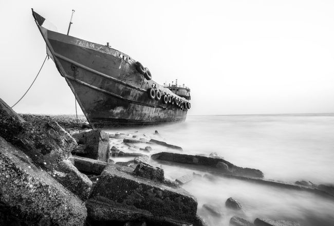 after heavy storm we found this boat on the beach and it was my chance to take some photos.. Blackandwhite Boat Fine Art Photography Ghost Island Light And Shadow Photography Sea Top