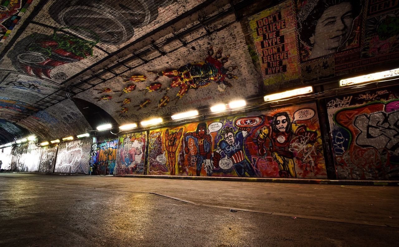 graffiti, creativity, art and craft, indoors, architecture, multi colored, street art, built structure, illuminated, no people, day