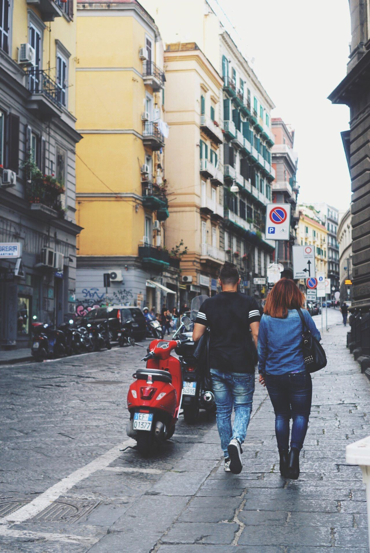 Two People City City Life Building Exterior Architecture Street Car Men City Street Women Built Structure Rear View Lifestyles Adult Adults Only Transportation Togetherness Full Length Outdoors Day Naples, Italy