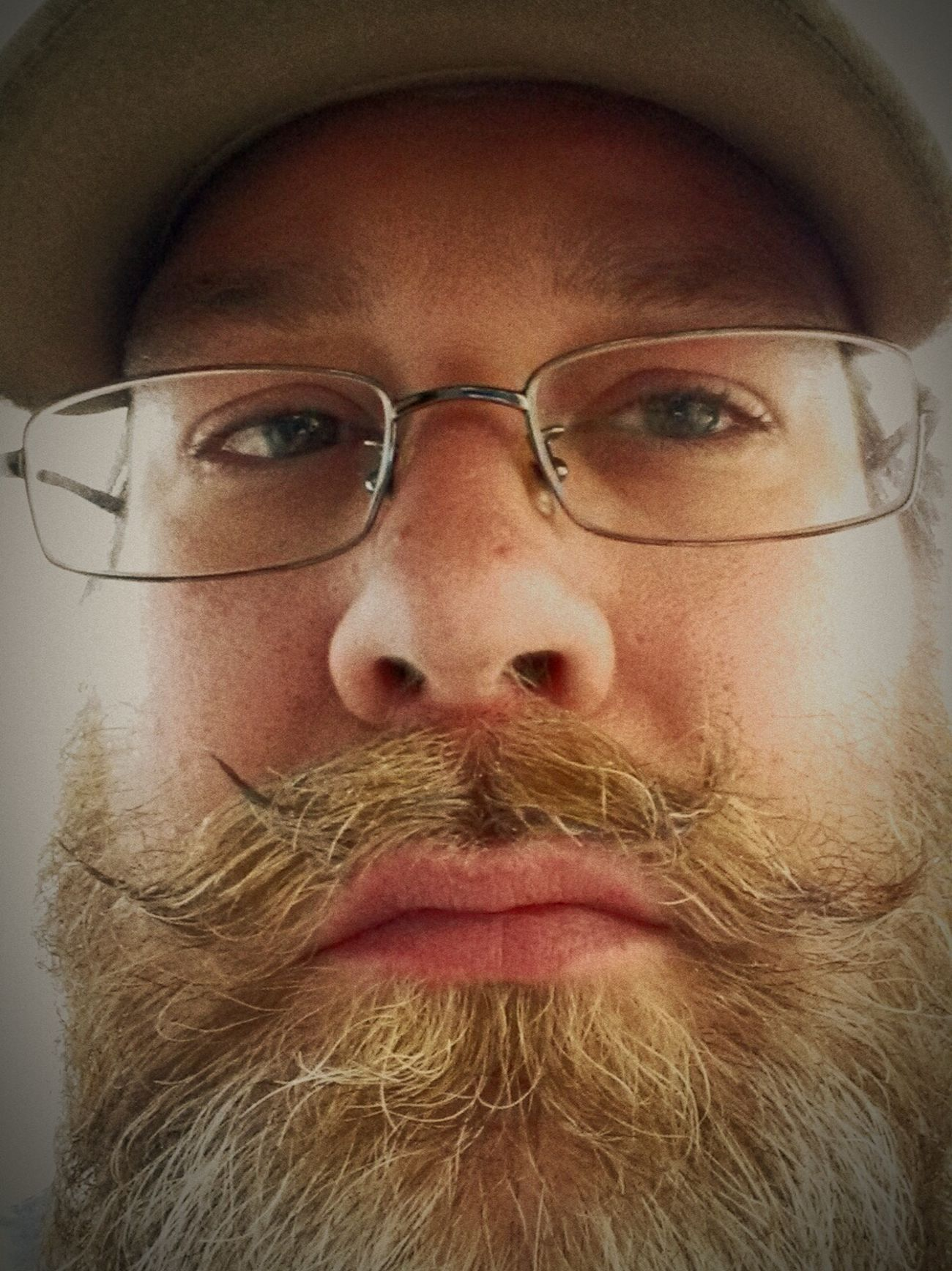 This is a photo of the photographer from last winter with a beard and two mustaches. Old glasses . breaking the selfie seal. Top Secret Mission Rustographer Urban Filter 4 Light And Shadow Motivated Observing Mustaches Selfie Portrait Closeup Bearded