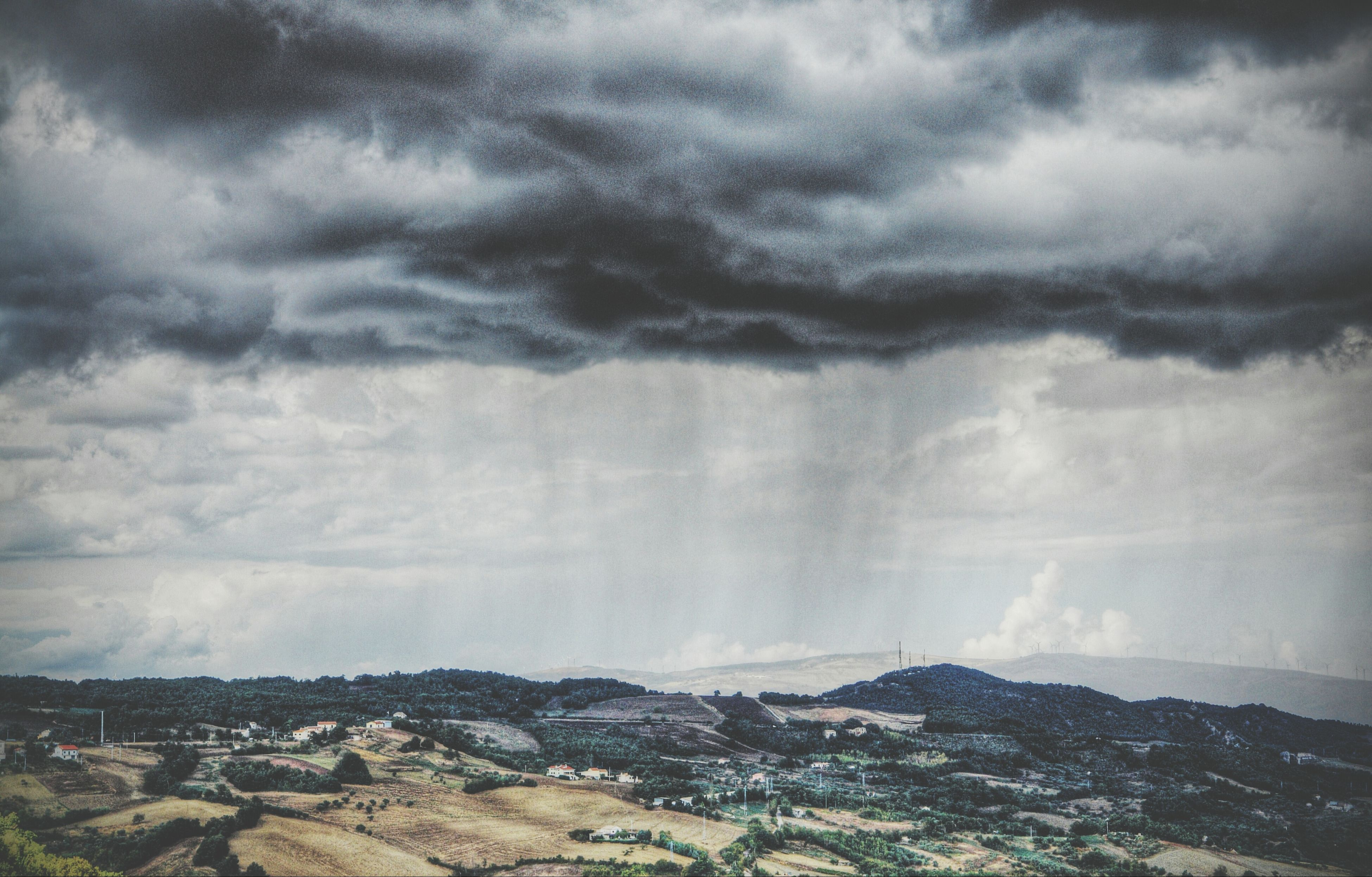 sky, cloud - sky, cloudy, scenics, landscape, beauty in nature, weather, tranquil scene, tranquility, nature, mountain, overcast, cloud, power in nature, idyllic, storm cloud, day, non-urban scene, outdoors, cloudscape