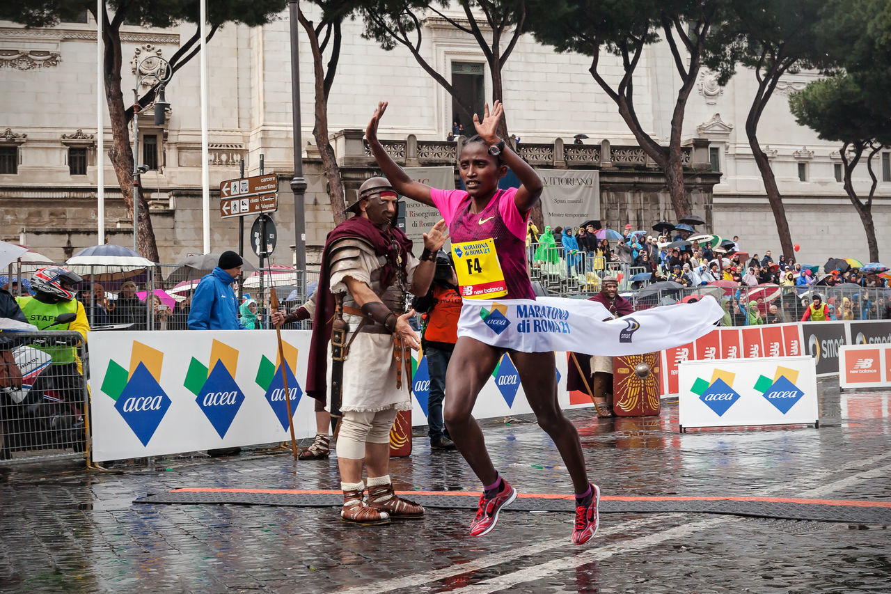 Rome, Italy - March 22, 2015: Meseret Kitata Tolwak crosses the finish line and won the women's race at Rome Marathon 2015. Athlete Ethiopian Finish Line  First Happiness Kitata Marathon Meseret Runner Running Winner Woman