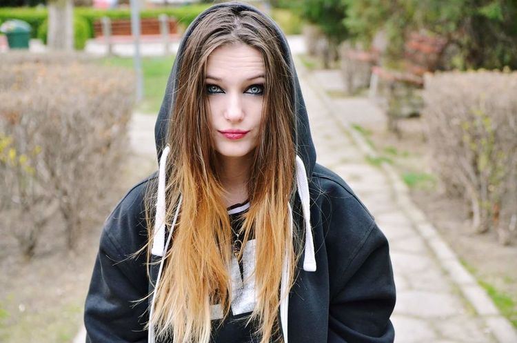 Long Hair Outdoors Day Lifestyles Young Women Blue Eyes Bad Look
