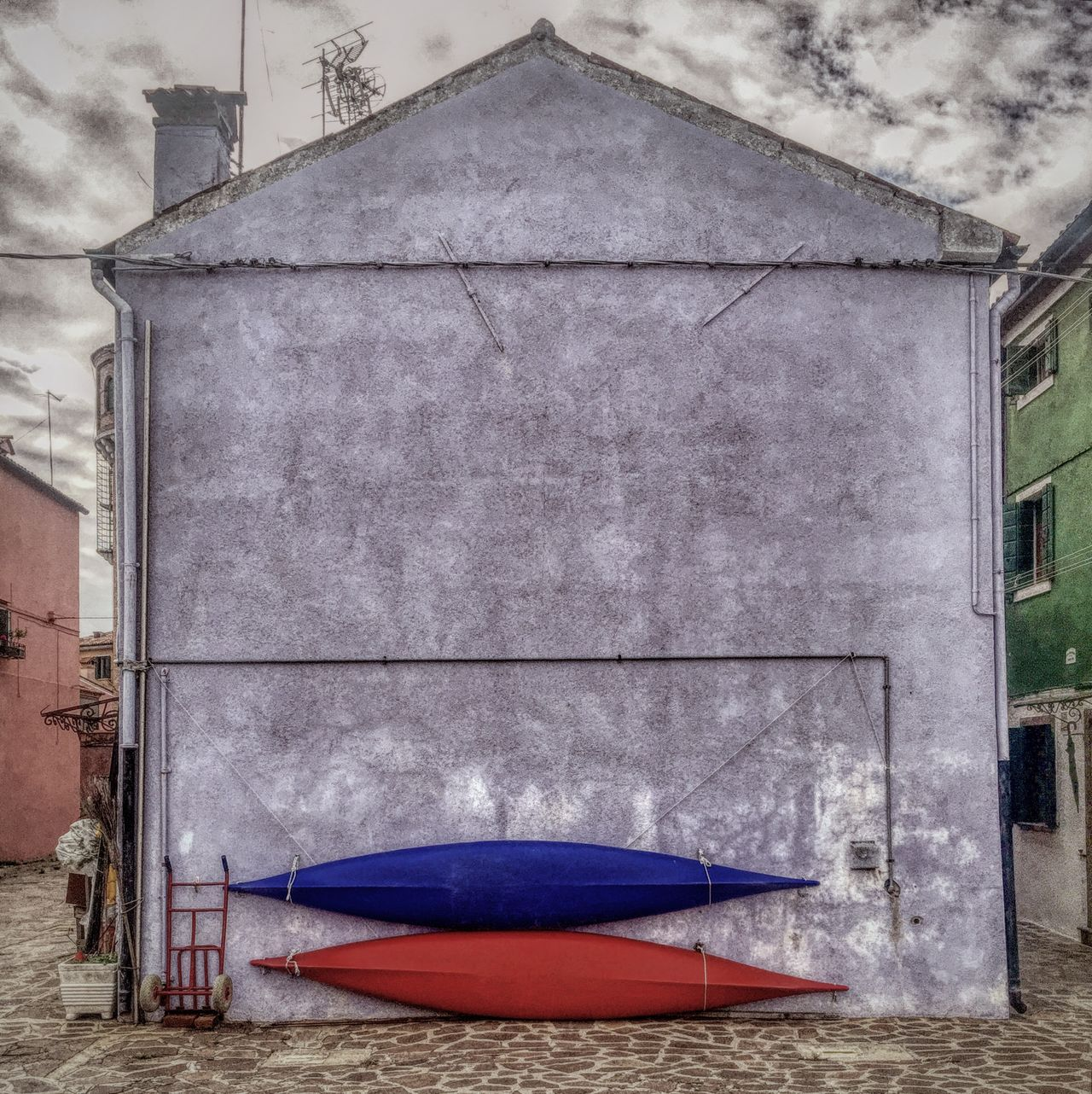 Architecture Blue Color Building Exterior Built Structure Canal Canoes Day House No People Outdoors Red Color Sky Texture