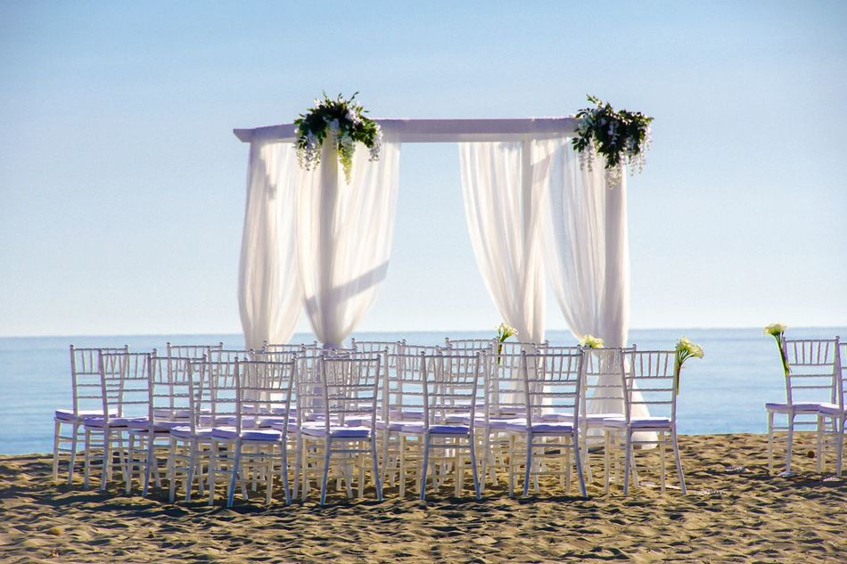 Beach Beauty In Nature Ceremony Chair Chairs Clear Sky Day Flower Horizon Over Water Nature No People Ocean Outdoors Row Sand Sea Sky Water Wedding Wedding Wedding Ceremony Wedding Photography