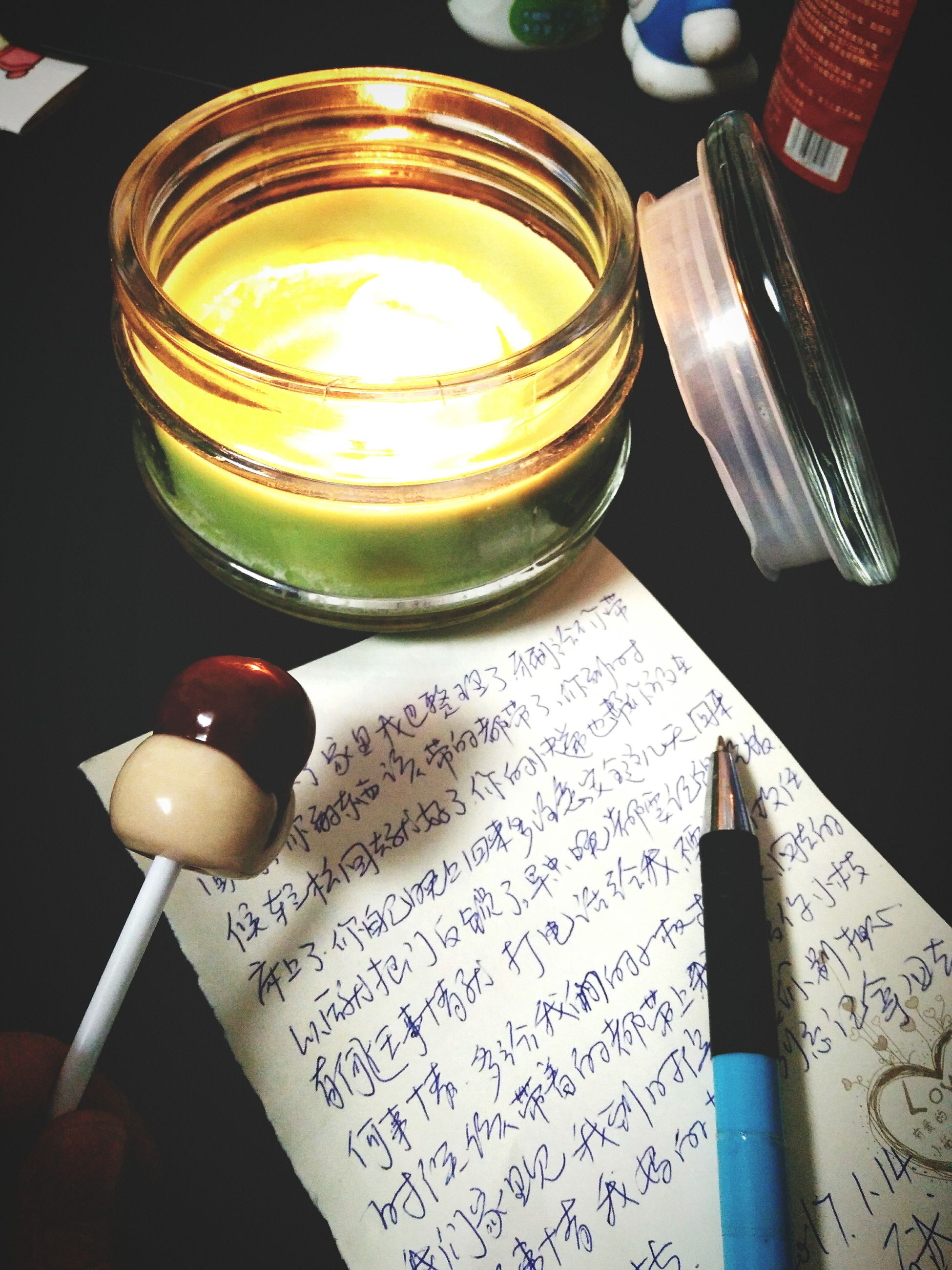 high angle view, indoors, table, close-up, text, jar, no people, tea light, day