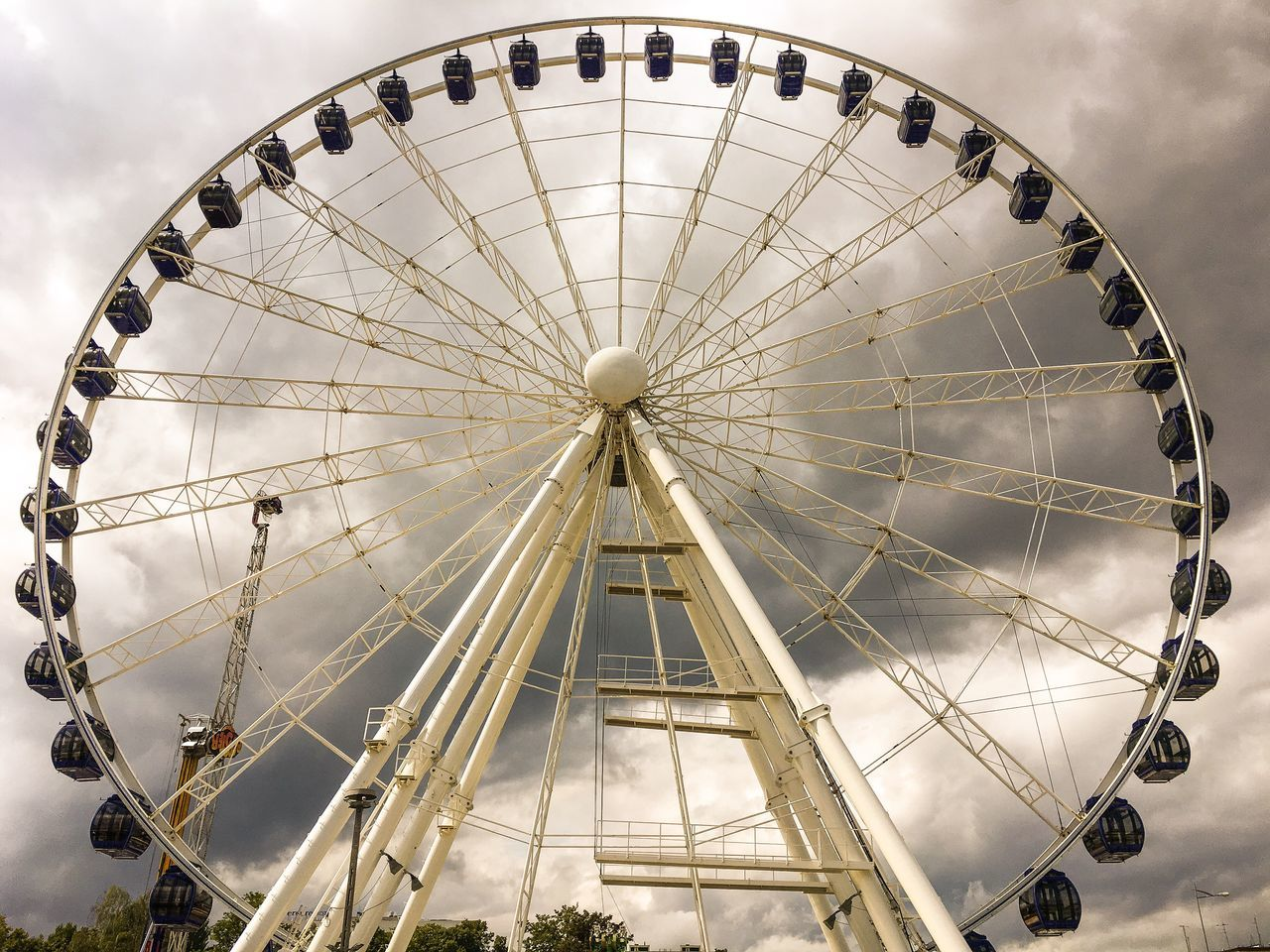 amusement park, arts culture and entertainment, ferris wheel, amusement park ride, low angle view, big wheel, no people, sky, day, outdoors, carousel, close-up