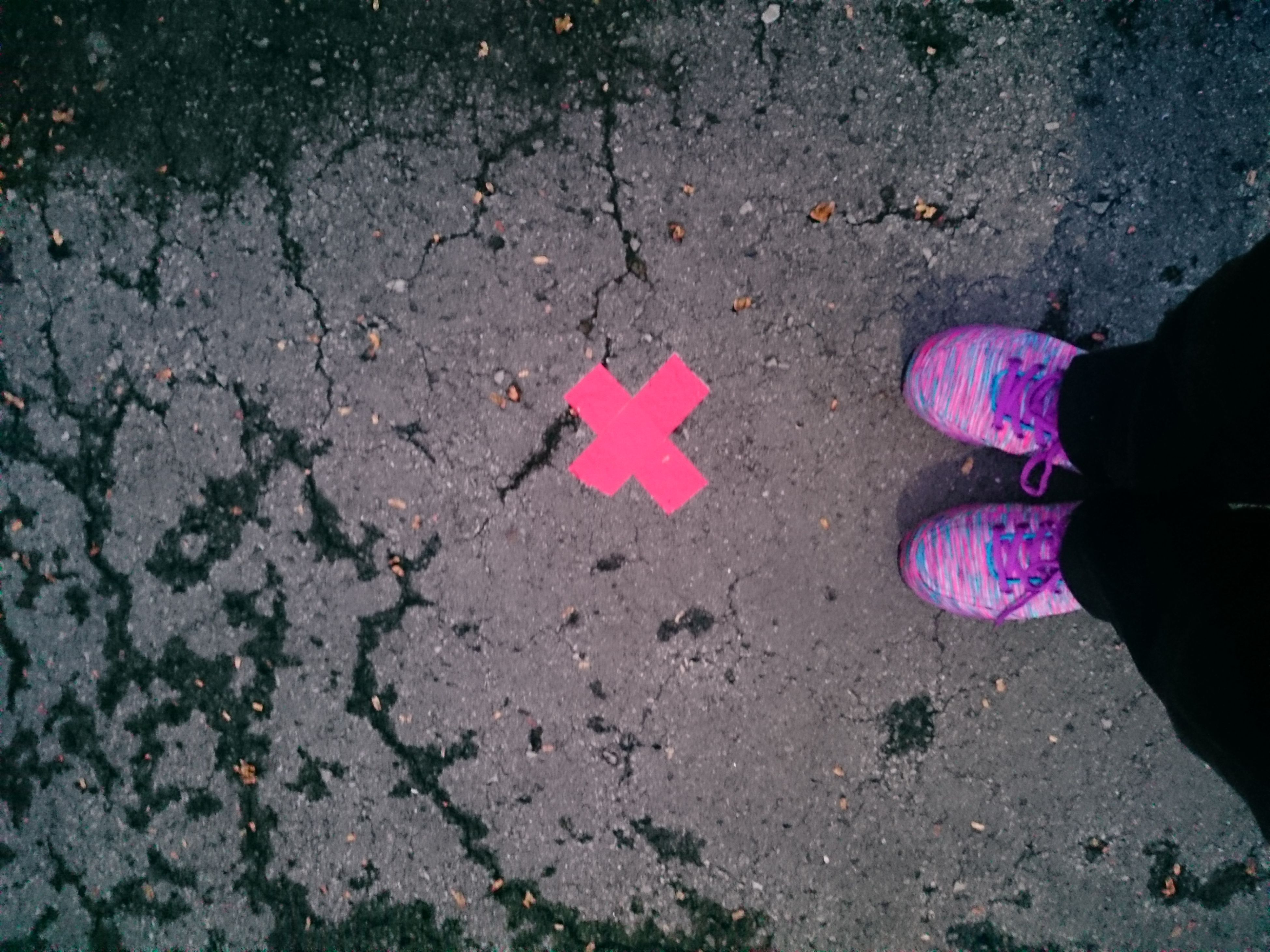 high angle view, real people, pink color, outdoors, road, one person, lifestyles, day, close-up, low section, people
