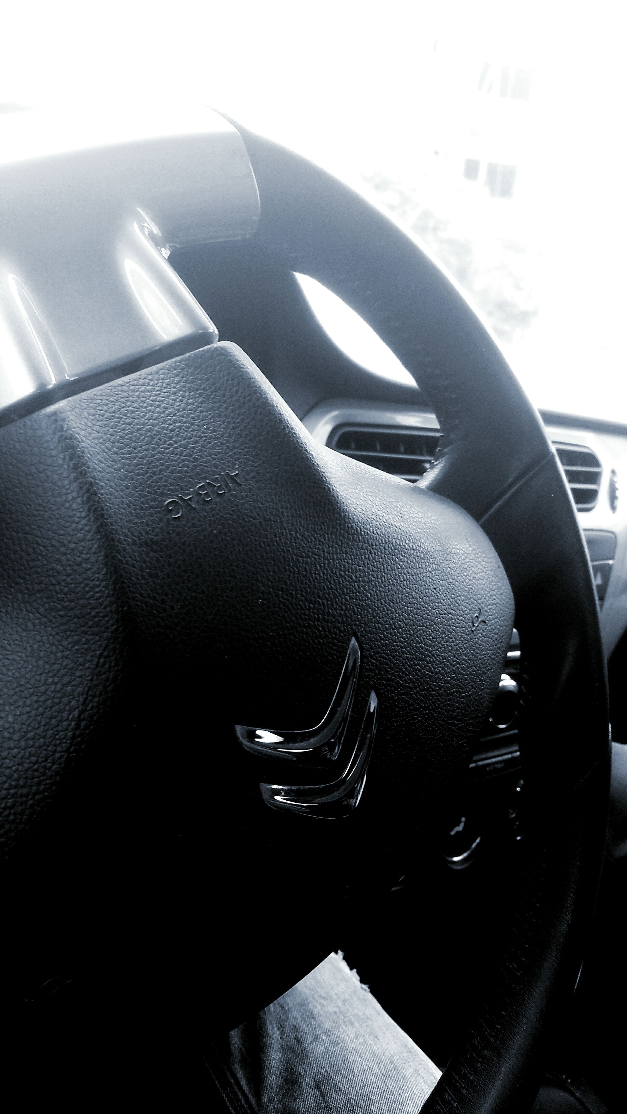 mode of transport, transportation, land vehicle, vehicle interior, car, car interior, part of, close-up, cropped, indoors, travel, steering wheel, windshield, vehicle seat, one person, vehicle part, reflection, glass - material, airplane, journey