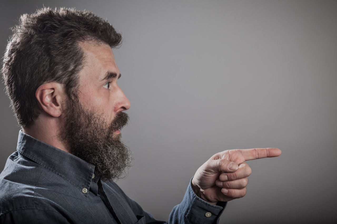 Mature man with long beard, head shots on grey background Adult Adults Only Beard Close-up Day Emotions Finger Grey Background Headshot Human Body Part Human Hand Indoors  Men One Man Only One Person Only Men People Pointing Portrait Series Studio Shot Young Adult