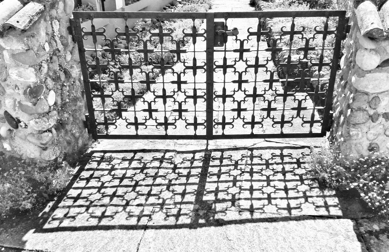 Einmal in bnw - Garden Door Shadows Shadows & Light Stonewalls Wrought Iron Wrought Iron Gate Outdoors No People Day Bnw Bnw Photography Bnwmood Garden Architecture Architecture Patterns Patterns Everywhere Pattern Photography Focus On Shadow