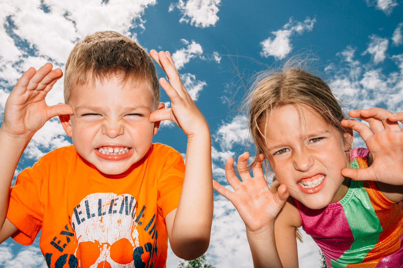 Brother and sister are making scary faces to the camera. Beauty In Nature Blue Sky Boy Brother Clouds Fun Funny Faces Girl Kids Scary Scary Face Siblings