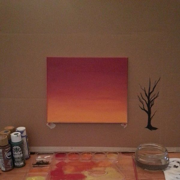 Painting in progress. This is going to be my first painting ever. The bare tree on the right is just practice. I am planning on painting silhouetted trees over this sunset background. I'm using acrylic paints. How does it look so far? My First Painting Inprogress firstpainting acrylics acrylic paint sunset silhouette trees tree cardboard easel pallet beginner art artist samsung galaxy phone camera photo photography instahub instagram insta instagood