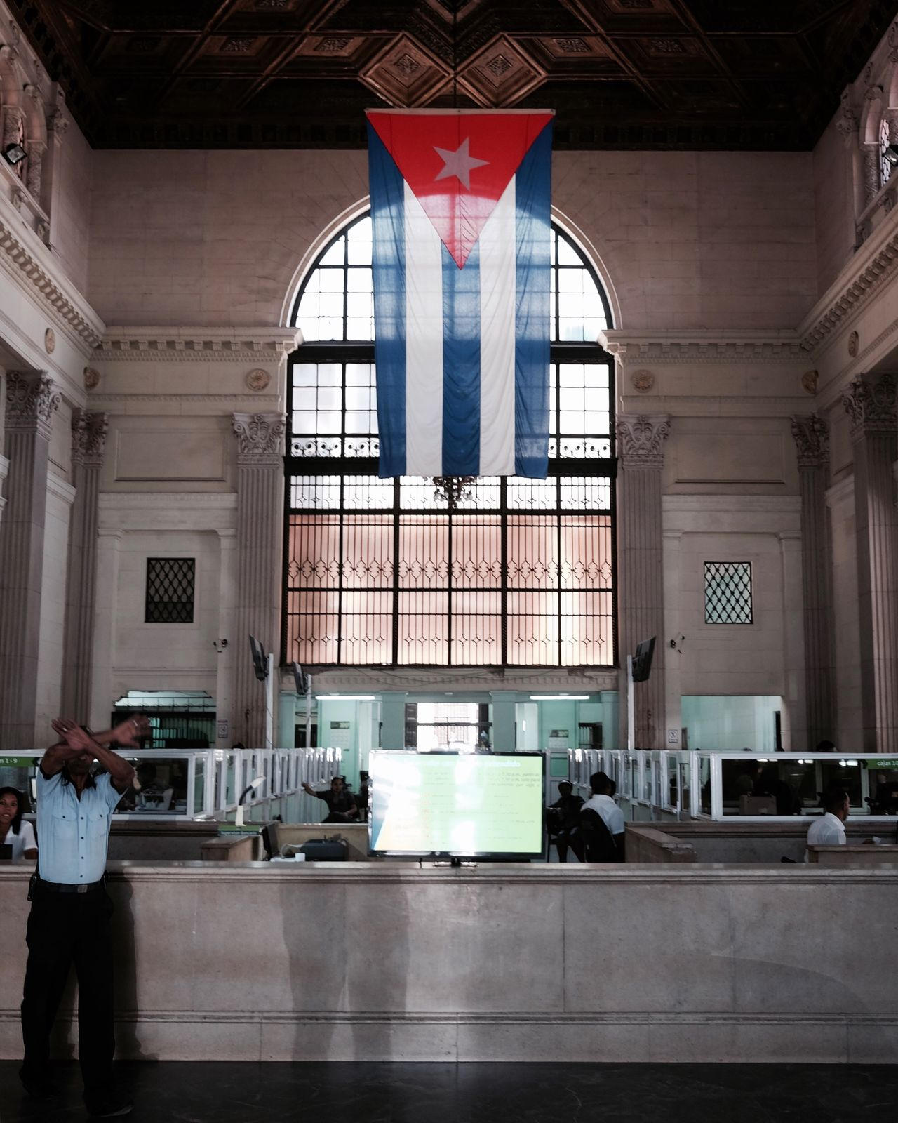 That fun moment when you act all polite and apologetic after being told by a heavily gesturing security guard to absolutely NOT take any photos and promise you won't take any but have already managed to fire off a few shots😉 One Person Real People Men Day Standing Architecture One Man Only People Adult Adults Only Bank Indoors  Travel Cuba Havana Flag Cuban Flag Security Security Guard