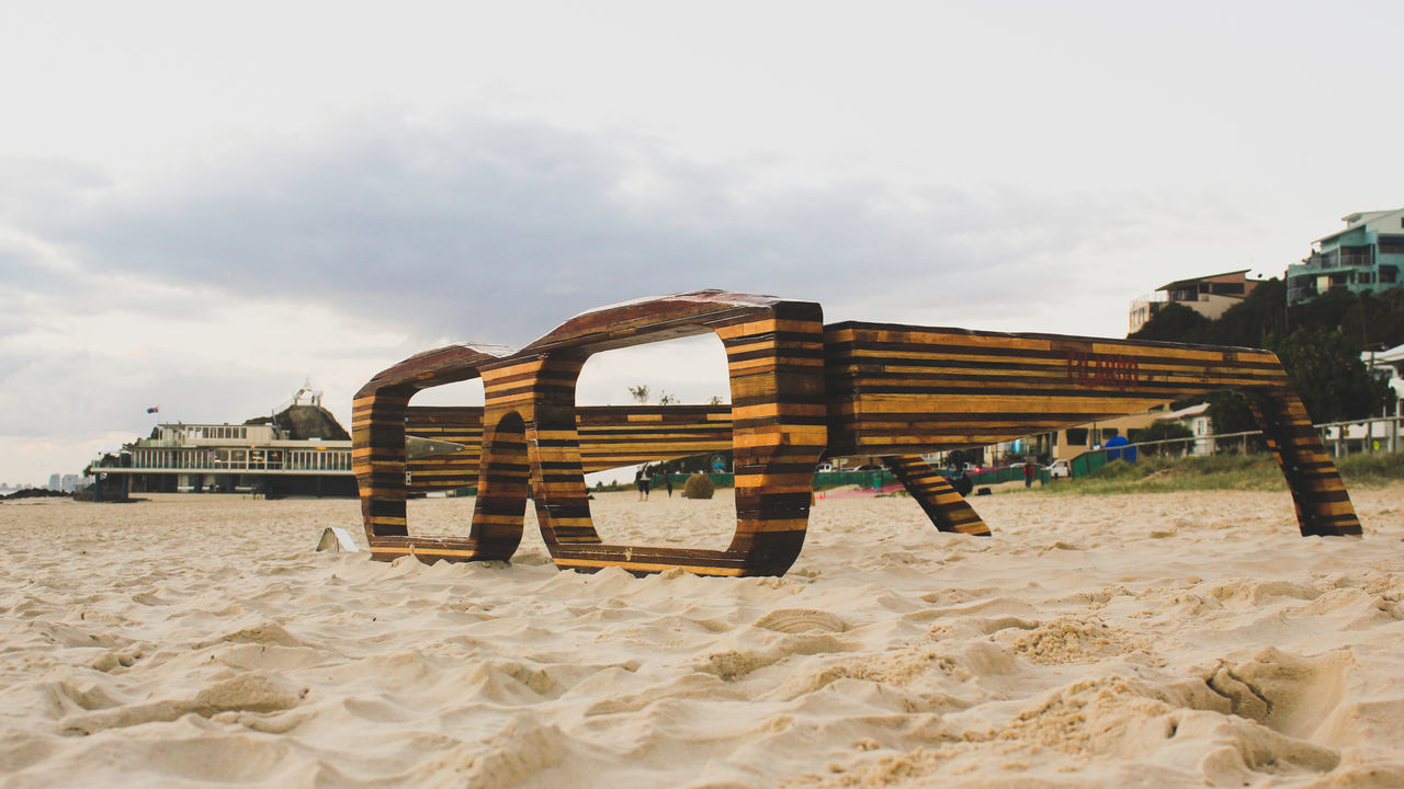 Wood glasses in sand Beach Built Structure Day Glasses Nature No People Outdoors Sand Sky Spectacles Wood My Year My View