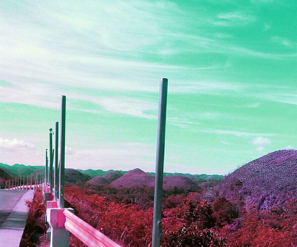 Tranquility Sky Tranquil Scene Plant Solitude Day Scenics Nature Outdoors Cloud - Sky Non-urban Scene Mountain Countryside Beauty In Nature Red Remote The Way Forward Myoriginslartwork Likeforlike Candyminimal Followme Bohol Philippines Chocolatehills
