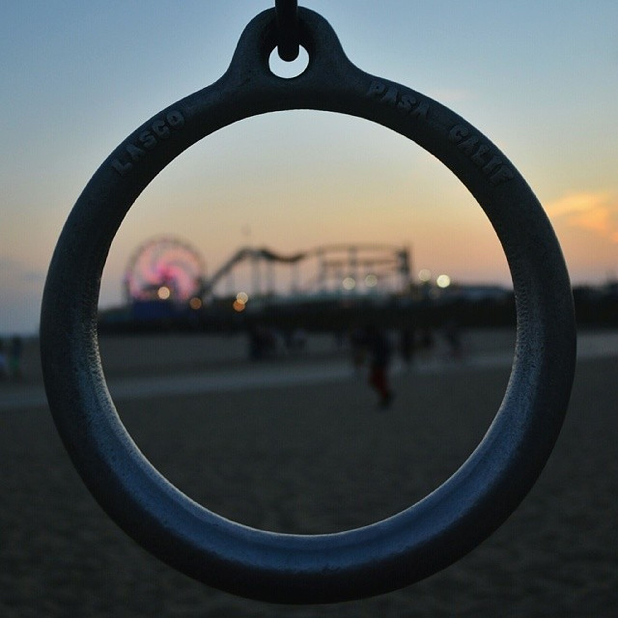 focus on foreground, metal, close-up, safety, sky, protection, circle, metallic, water, fence, security, sunset, no people, selective focus, outdoors, focus on background, sport, railing, day, city