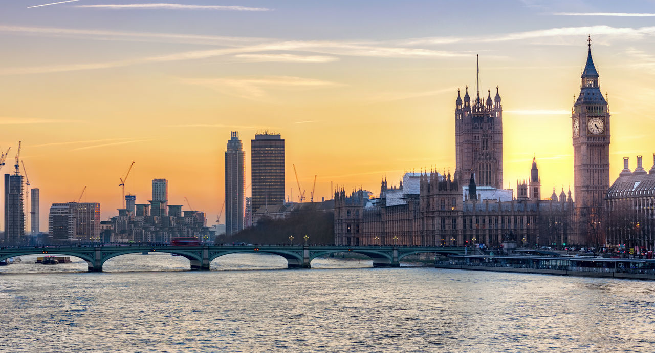 The skyline of London with the Big Ben and Westminster at sunset Architecture Bridge Built Structure City Cityscape Clock Tower Government Landmark London No People Outdoors River Sky Sky And Clouds Skyscraper Sun Sunset Tall - High Thames Tower Travel Destinations United Kingdom Urban Skyline Water Westminster