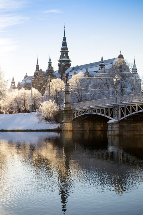 Winter wakes up. Snowflakes fell on Stockholm during last weekend after the Christmas. This picture was taken in the cold winter morning on Dec 29, 2015 Architecture Bridge Destinations Djurgården Europe Island Nordic Countries Nordic Museum Scandinavia Season  Season  Snow Snow ❄ Snowflake Stockholm Sweden Travel Water Water Reflections Winter