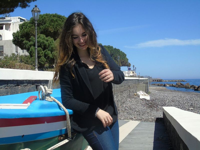 Snap A Stranger Italygram City Outdoors Illuminated Italy Maximum Closeness Focus Object Nature Water Travel Destinations Day Vacations Only Women One Woman Only One Person Adults Only One Young Woman Only Carefree Day Young Adult Happiness Outdoors Adult Young Women