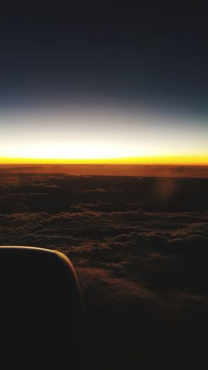 Horizon Vacations Scenics Sunset Aerial View Travel Airplane Sky Travel Destinations Business Finance And Industry Air Vehicle Landscape Night City Outdoors No People Cityscape Aerospace Industry Clear Sky Astronomy Perspectives On Nature