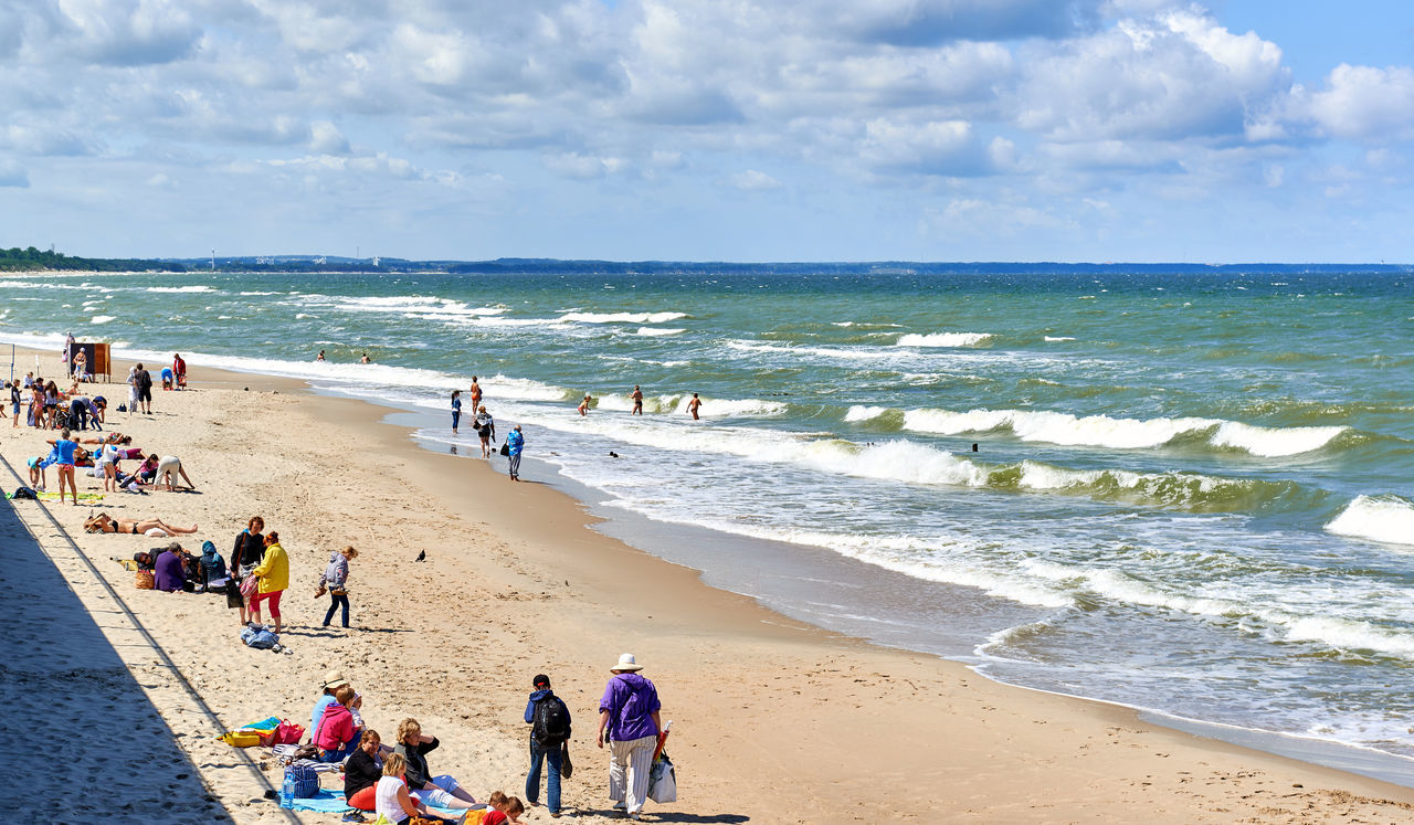 Zelenograd, Russia - July 16, 2016: Crowd of people on a beach of Zelenograd. Curonian spit, Kaliningrad region. Russia Baltic Sea Beach Breaking Waves Cloud - Sky Coast Curonian Spit Editorial  Holiday Horizon Over Water Kaliningrad Landscape Large Group Of People Leisure Outdoors People Russia Seasonal Summer Summertime Sunbathing Tourism Tourists Vacations Walk Zelenograd