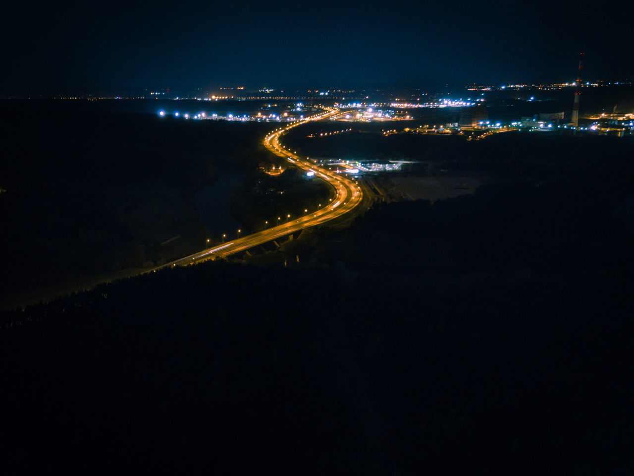 Winding road - at night from drone Areal City City City Lights Cityscape Dark Distance Dji Drone  Forest Highway Horizon Illuminated Long Exposure Mavic Mavic Pro Nature Night Night Lights Nightphotography Road Sky Town Trails Winding Road