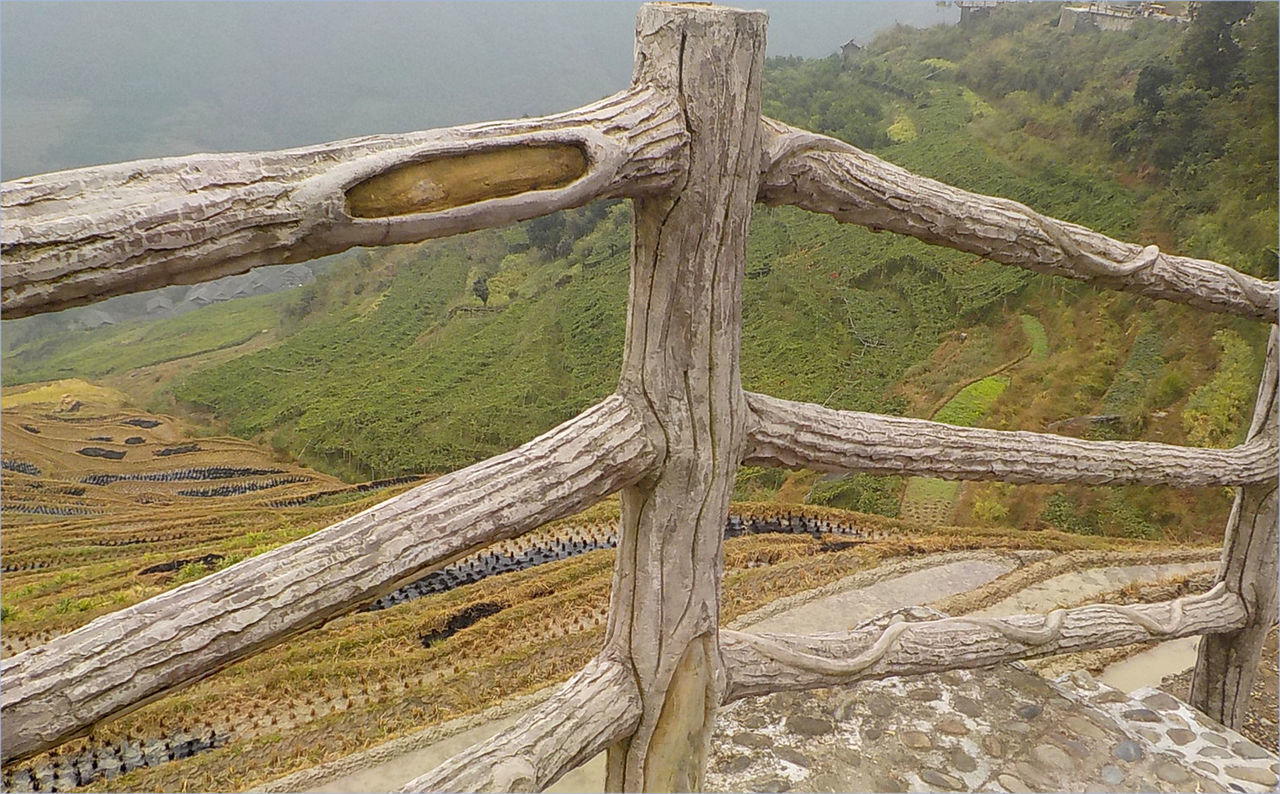 Fence Overlooking Harvested Rice Paddies Beauty In Nature Day Green Color Harvested Rice Paddies Landscape Mountain Nature No People Outdoors Rice Paddy Rice Terraces Scenics Sky Tranquil Scene Tranquility Water Wooden Fence