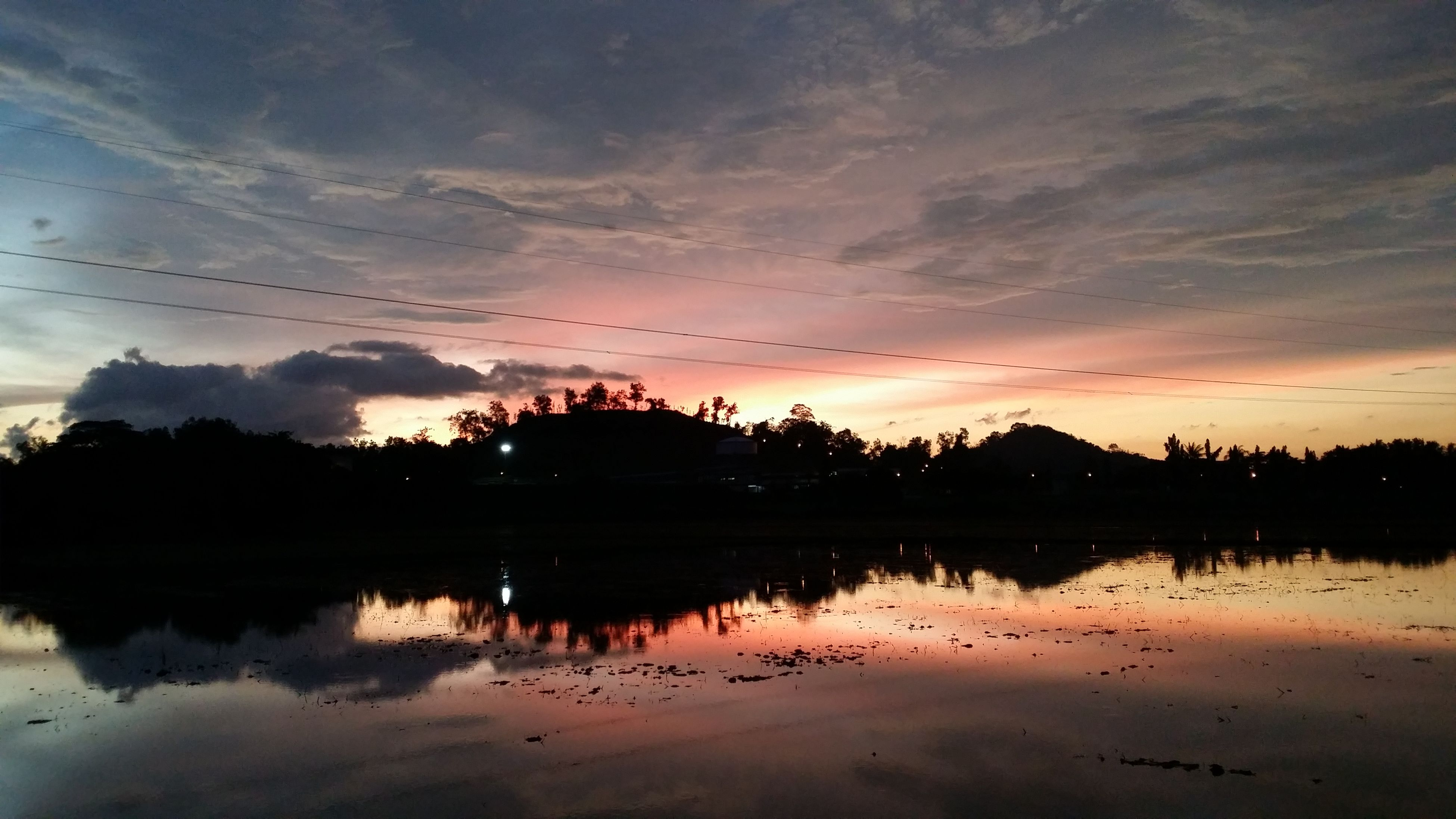 reflection, sunset, water, tranquil scene, tranquility, scenics, sky, lake, silhouette, beauty in nature, cloud - sky, tree, idyllic, nature, cloud, waterfront, orange color, standing water, calm, dusk