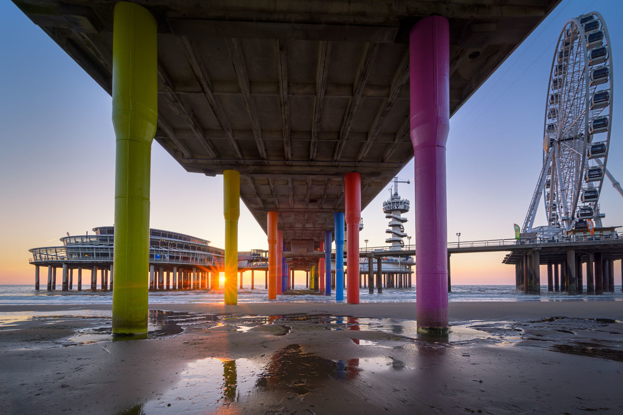 The famous landmark The Pier in Scheveningen as seen from underneath. Architecture Beach Built Structure Day Landmark Netherlands No People Outdoors Pier Sand Scheveningen  Scheveningen Pier Shore Sky Sunset The Hague Travel Water