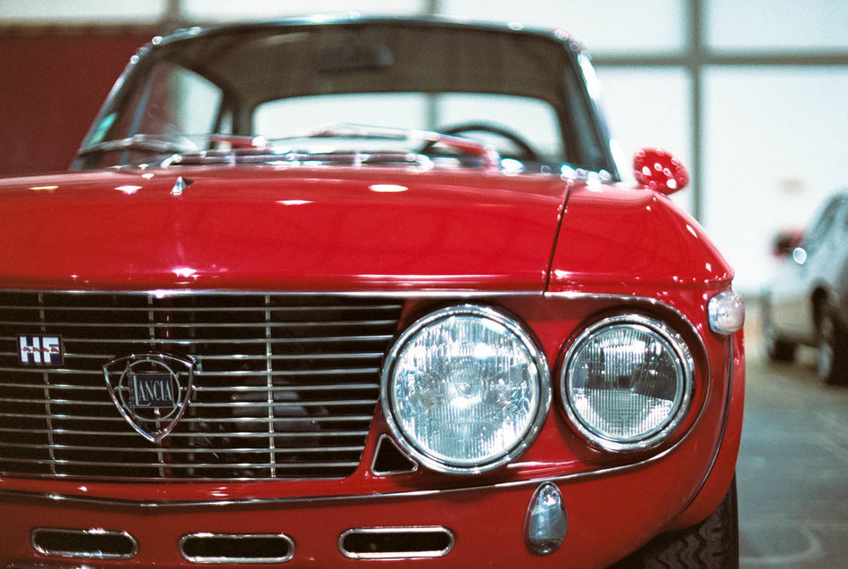 "Lancia Fulvia Rallye 1.6 HF ""Fanalone"" Olympus OM-2n Zuiko 50mm f/1.4 Fujifilm PRO 400H @ 800 35mm Film 50mm Analogue Photography Bokeh Car Classic Classic Car Close-up Detail Film Film Photography Filmisnotdead Indoors  Lancia No People Old-fashioned Red Retro Styled Transportation Vintage Car"