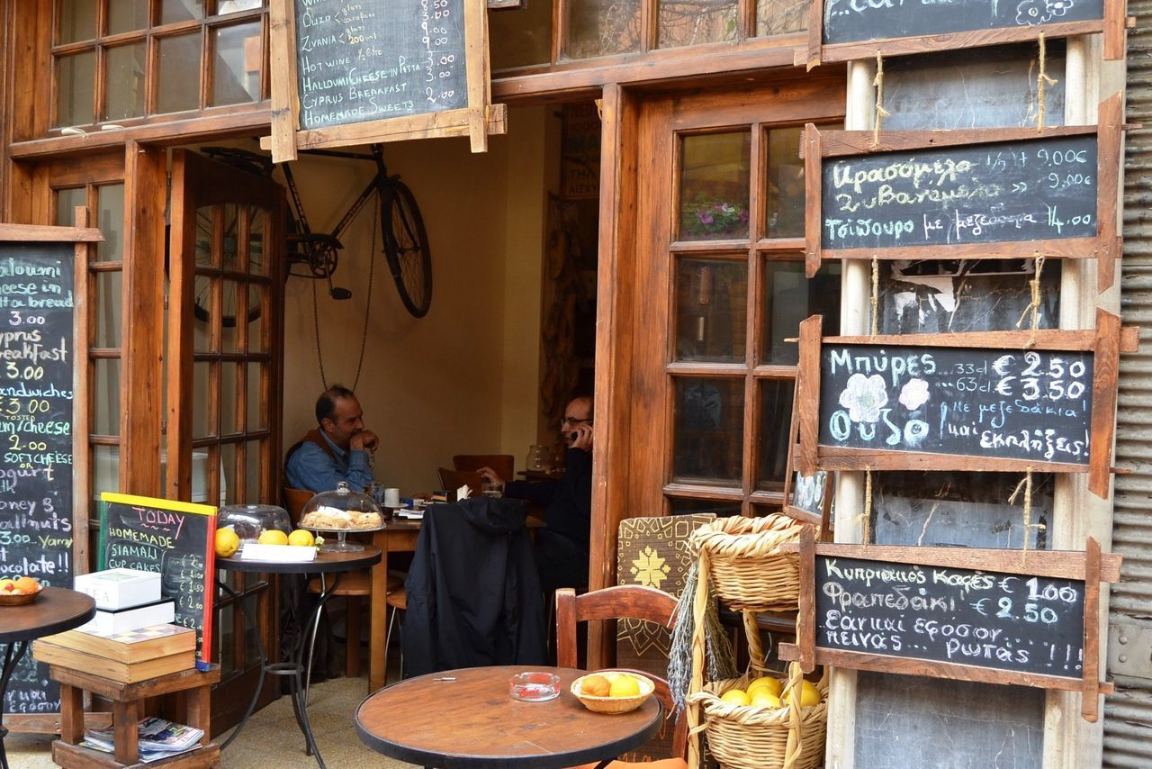 Street Cafe Culture of Nicosia, Cyprus and just how big is the menu here! Blackboard Sign Cafe Chairs Coffee Shop Scene Coffee Time Doors Street Cafe Street Photography Tables Travel Photography