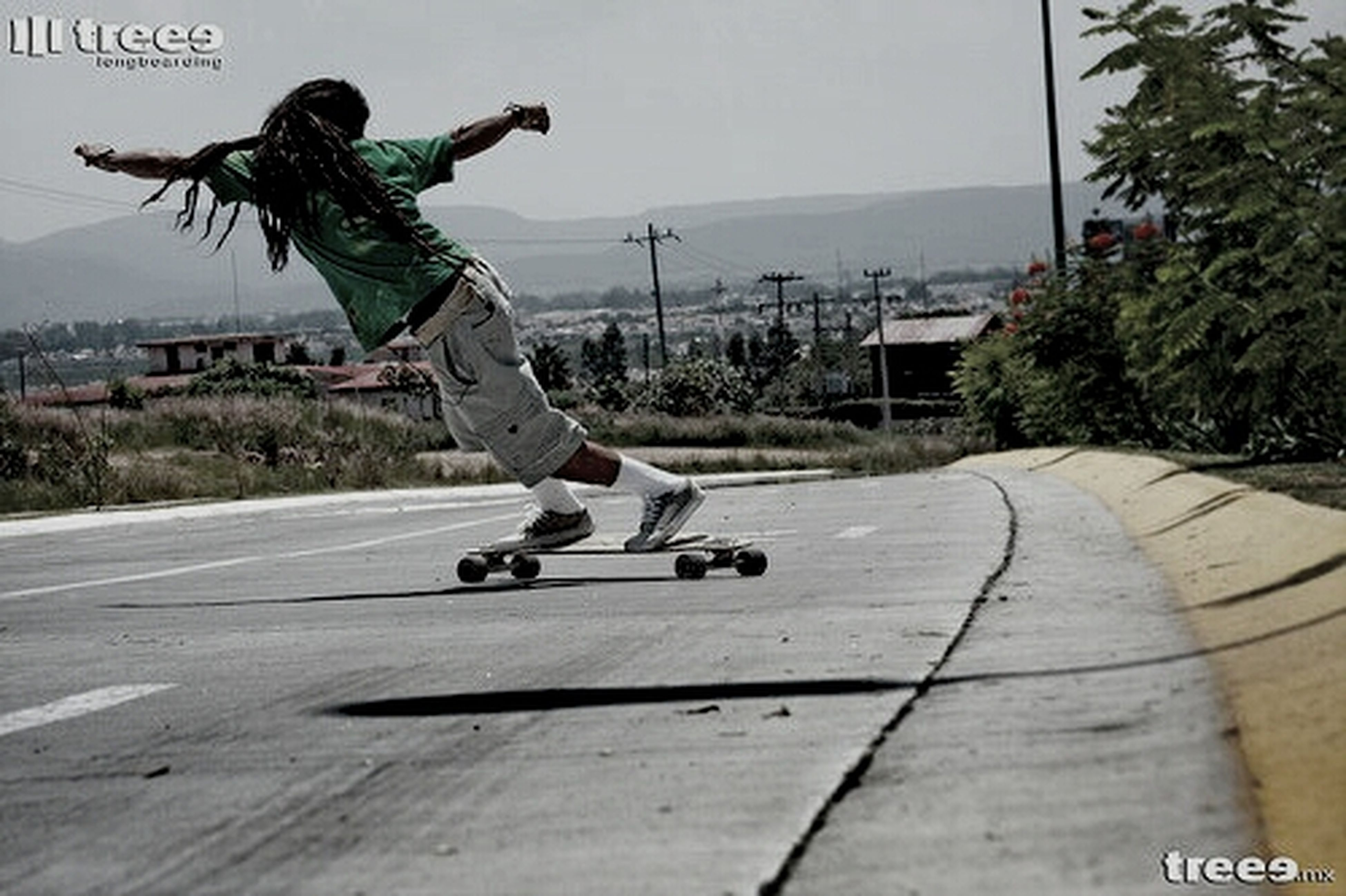 lifestyles, leisure activity, full length, men, skill, skateboard, jumping, mid-air, sport, casual clothing, young adult, skateboarding, transportation, street, built structure, riding, building exterior, holding